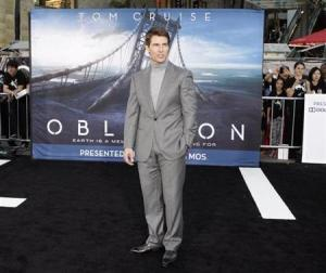 "Cast member Tom Cruise poses at the premiere of his new film ""Oblivion"" in Hollywood, California"